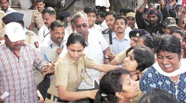 Trupti Desai, leader of the Bhumata Brigade, being dragged away by police during an attempt to offer prayers at the Shani Shingnapur temple. (The Indian Express Photo)